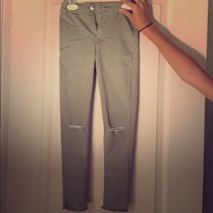 Zara never used green ripped jeans